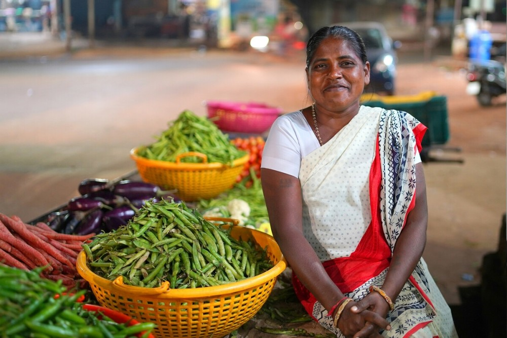 A woman in India selling vegetables