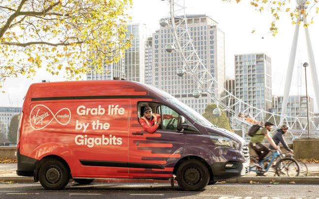 "A Virgin Media van driving through London, the text on the side of the van reads: ""Grab life by the Gigabits"""