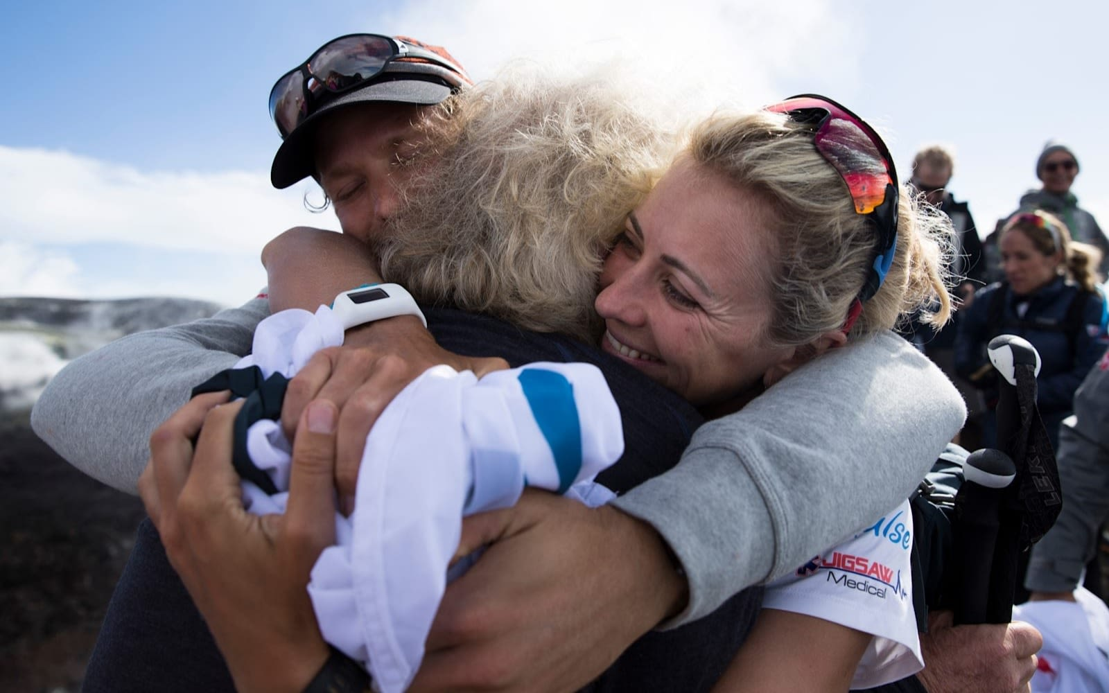 Richard Branson hugging family after a hike