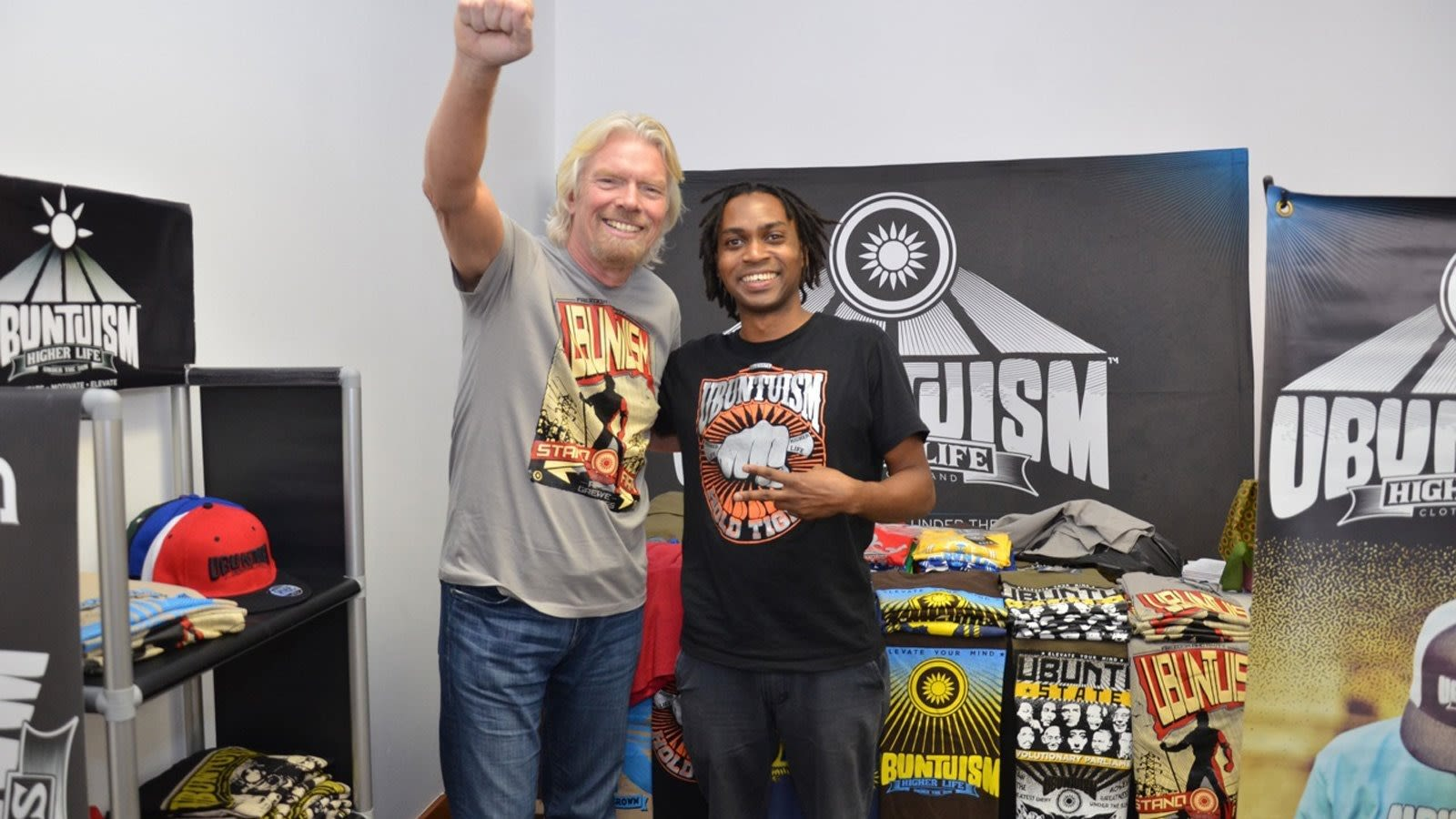 Richard Branson and man with Unbuntuism slogan shirt with surrounding merchandise