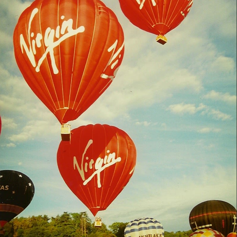 Three Virgin balloons taking to the sky at the Bristol Balloon Fiesta