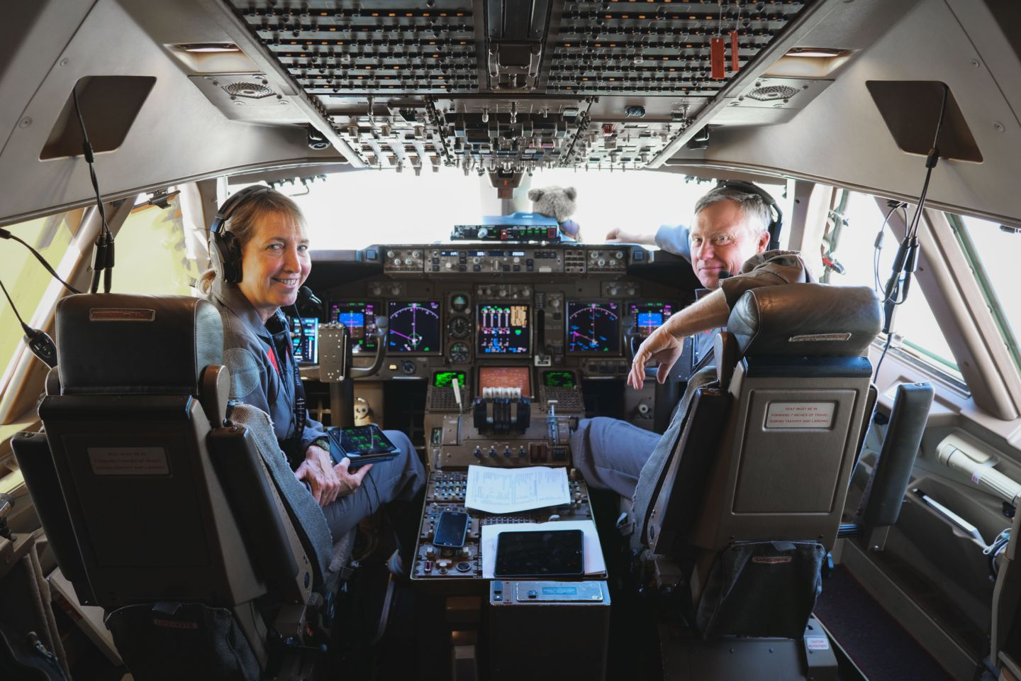 Virgin Orbit pilots smile from the flight deck on Cosmic Girl