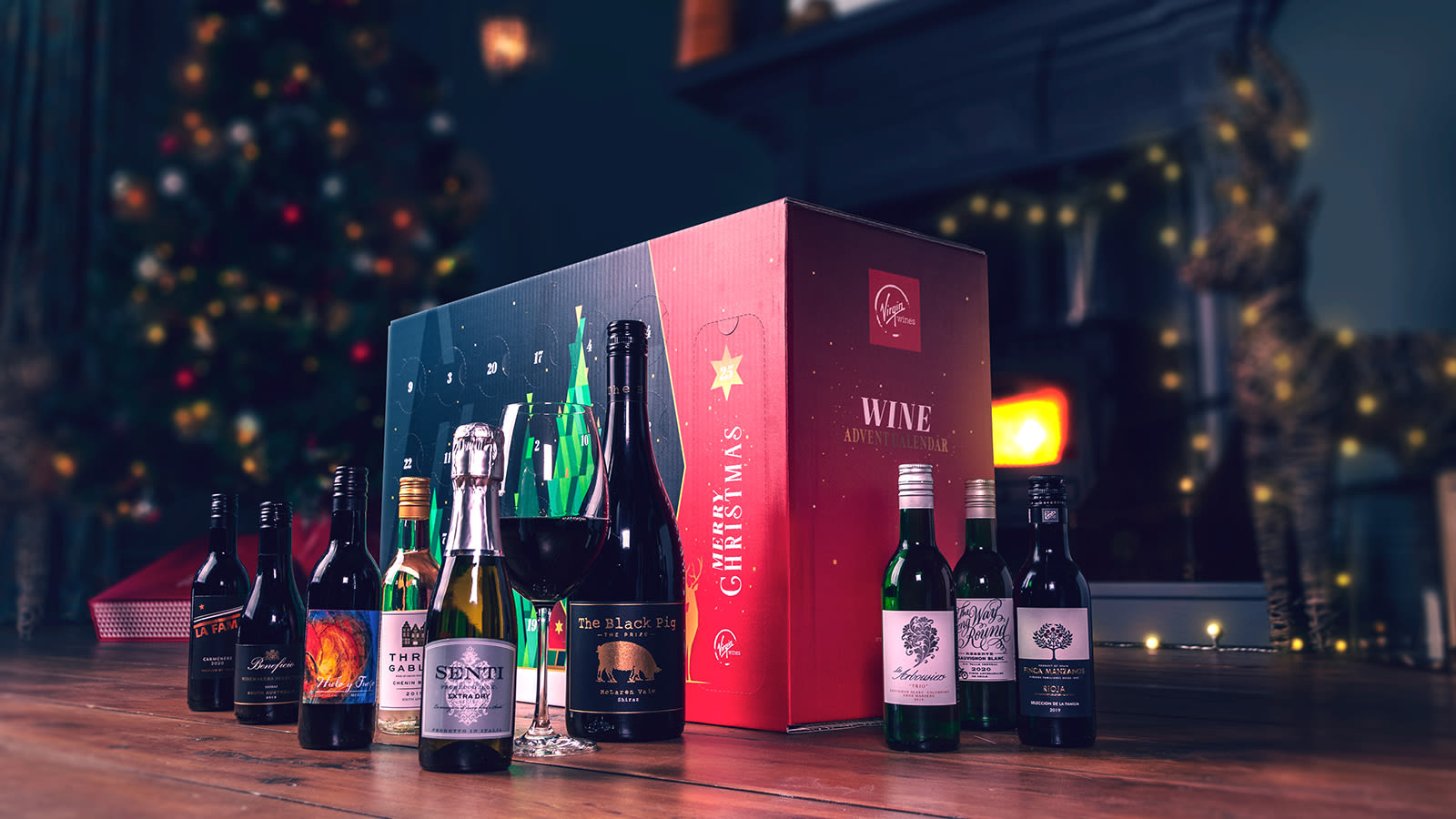 A Virgin Wines advent calendar with seven small bottles of wine and one large bottle of wine