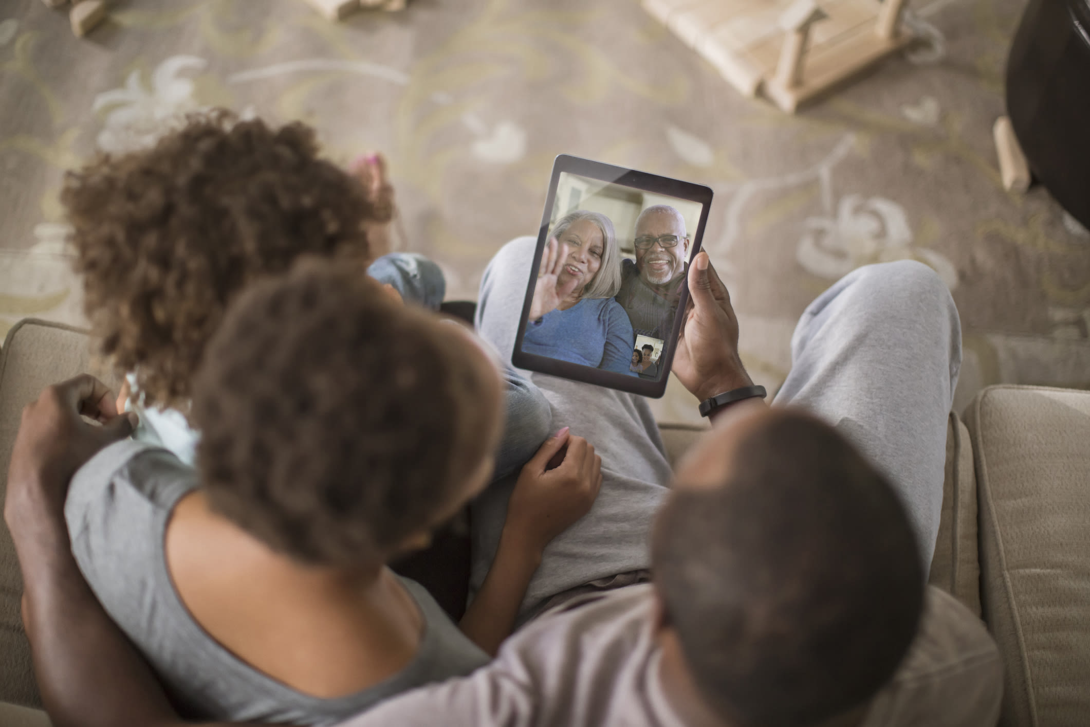 A family video chatting on a tablet