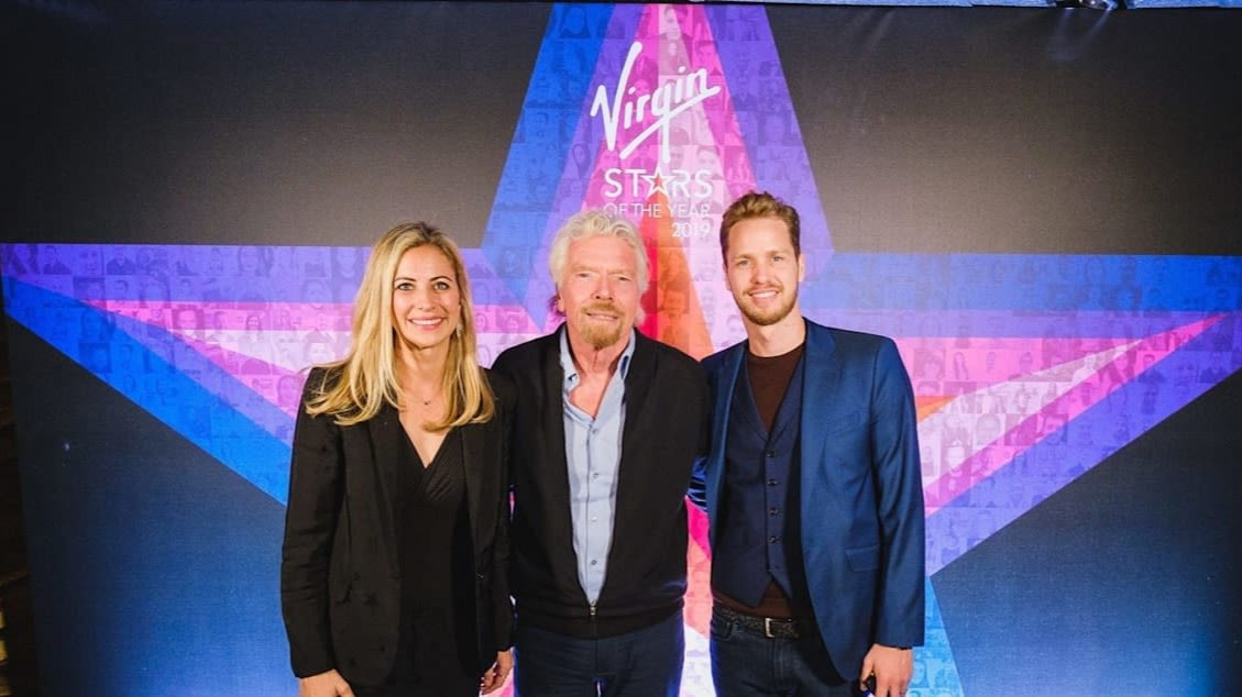 Holly Branson, Richard Branson and Sam Branson standing in front of the Virgin Stars logo