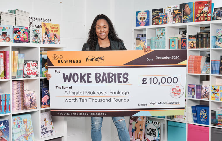 Woke Babies founder Kelly-Jade Nicholls holding a giant cheque from Virgin Media Business