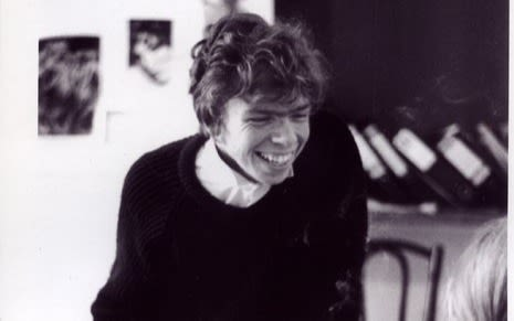 Black and White image of Richard Branson as a student. Smiling in his office