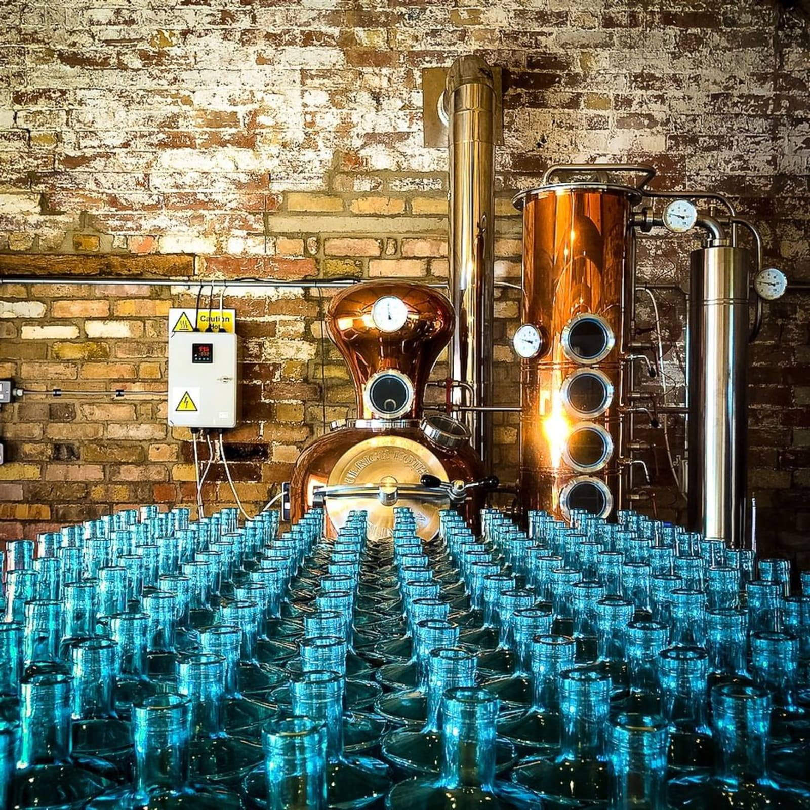 Image from the Roundwood Gin distillery with blue gin bottles