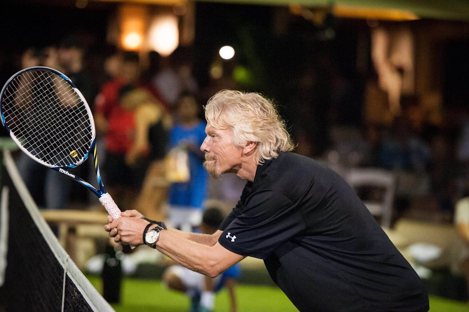 Richard Branson holding a tennis racket