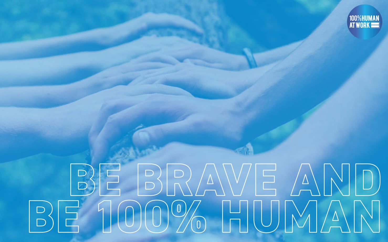 Be brave and be 100% human written on blue background showing a number of hands on a tree trunk