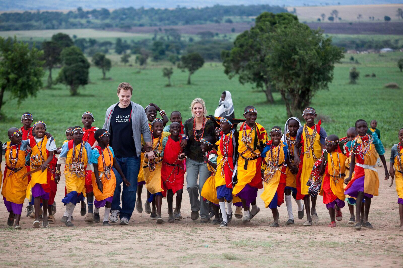 Holly Branson in Kenya walking with children from the Maasai Mara