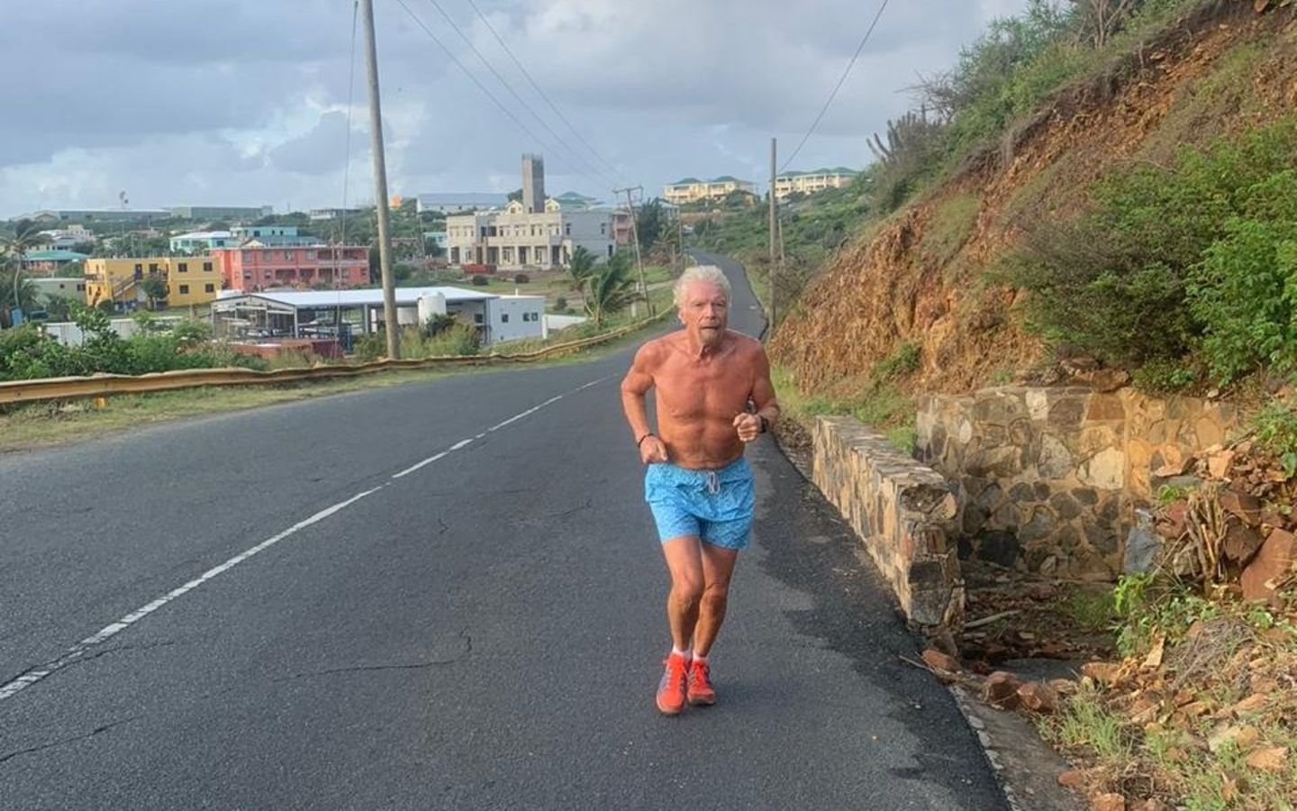 Richard Branson running up a hill