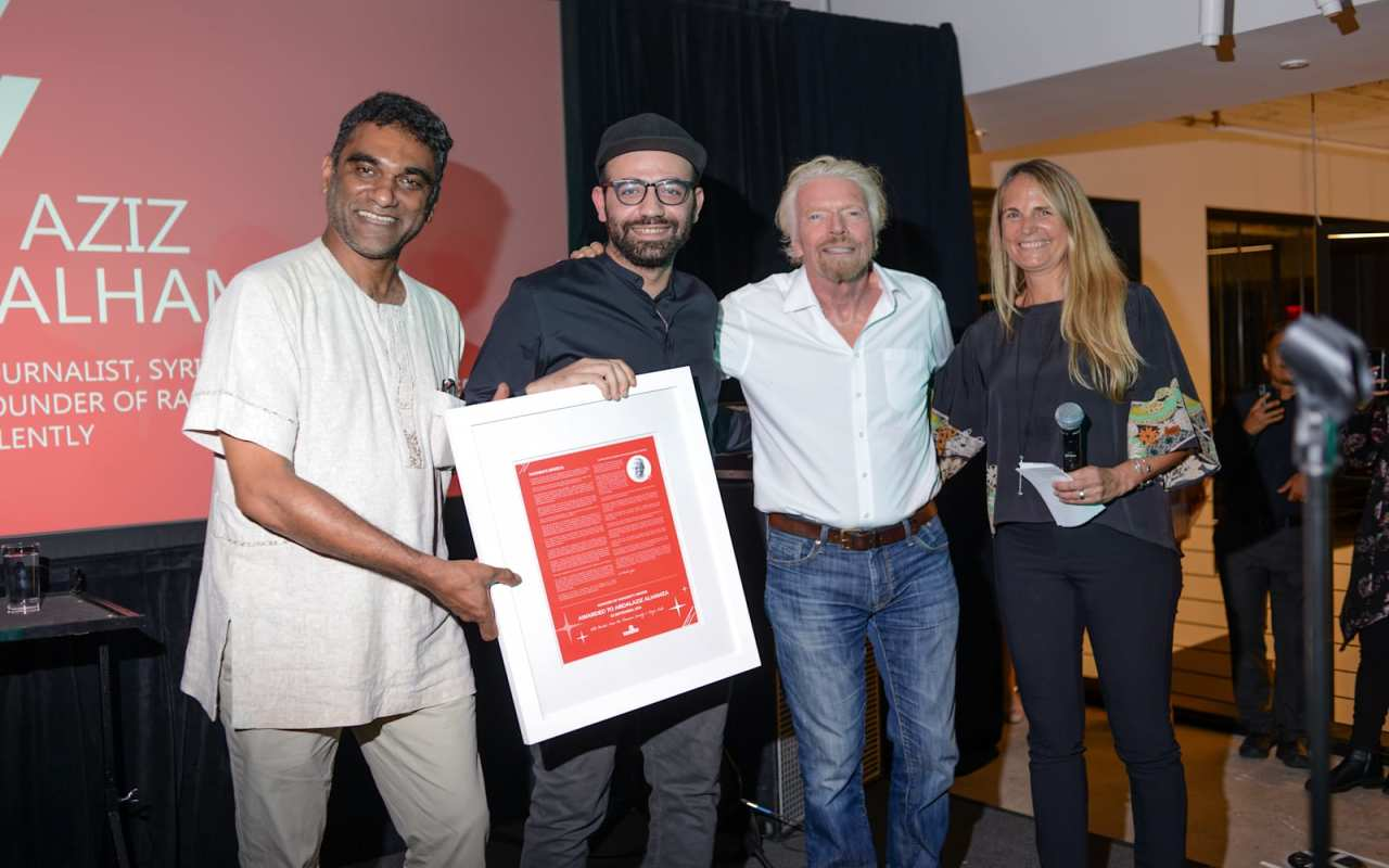 Richard Branson on stage with three people for Virgin Unite 15th Anniversary