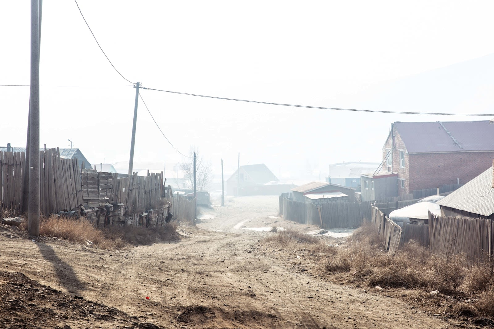 A view of a misty, derelict street