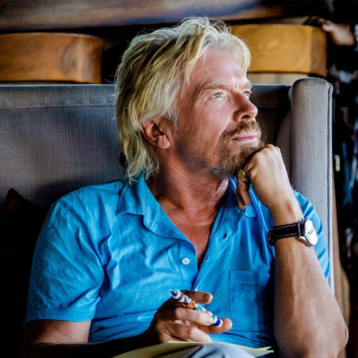 Richard Branson sitting down looking pensive