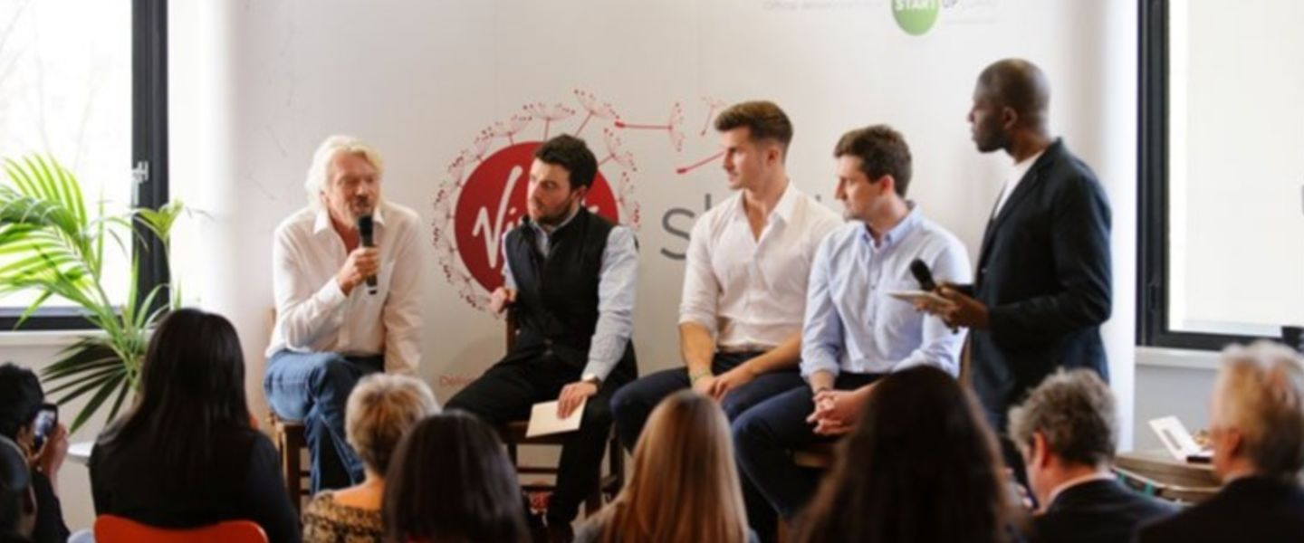Richard Branson speaking at a panel discussion at the Virgin office in London
