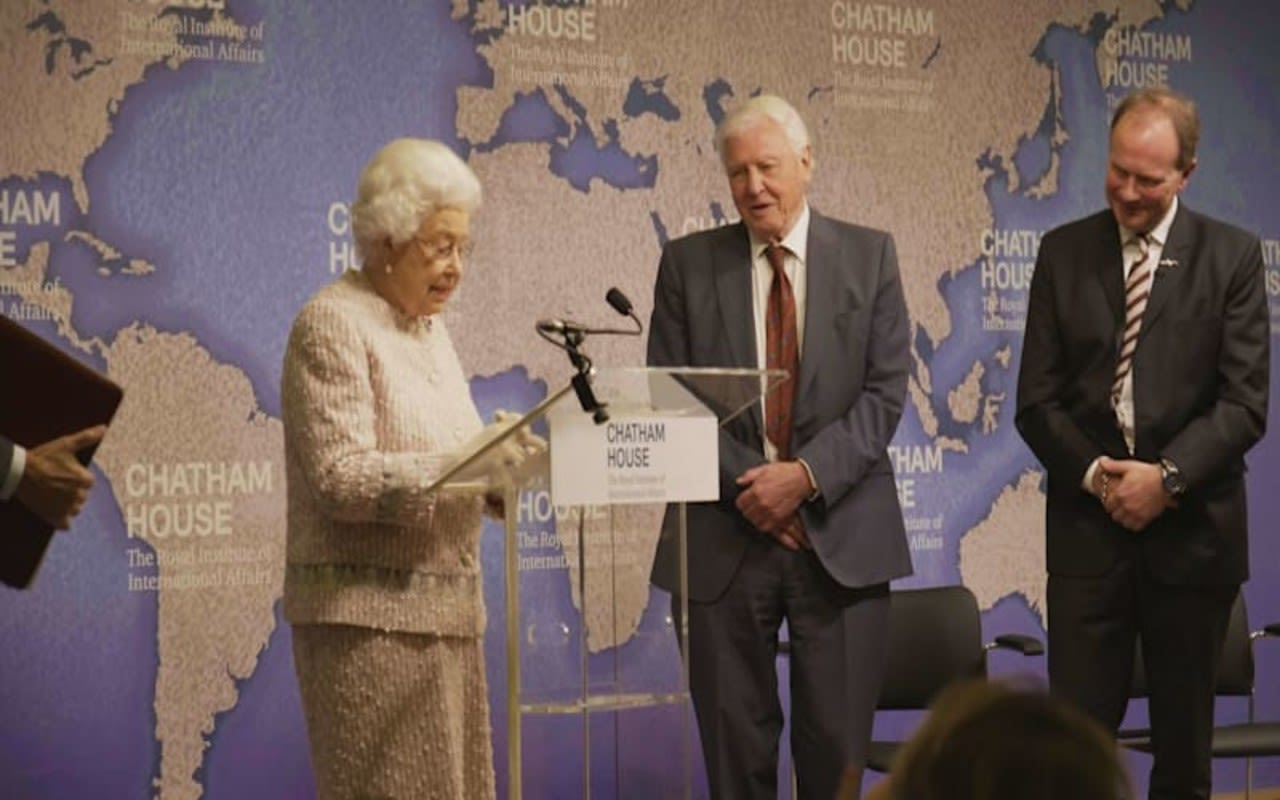 The Queen standing with David Attenborough on a stage