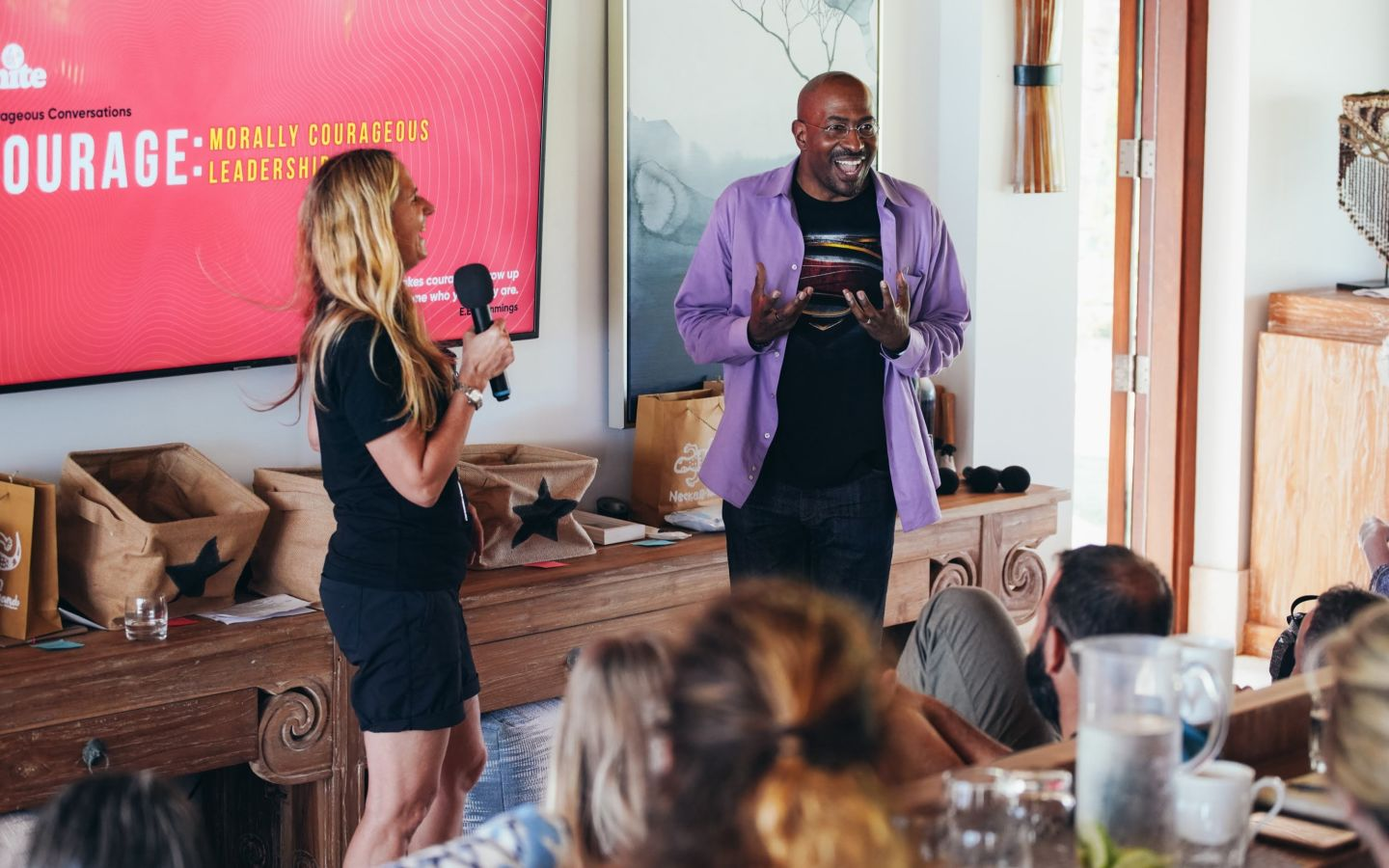 Van Jones and Jean Oelwang smiling and speaking to a group during a Virgin Unite gathering