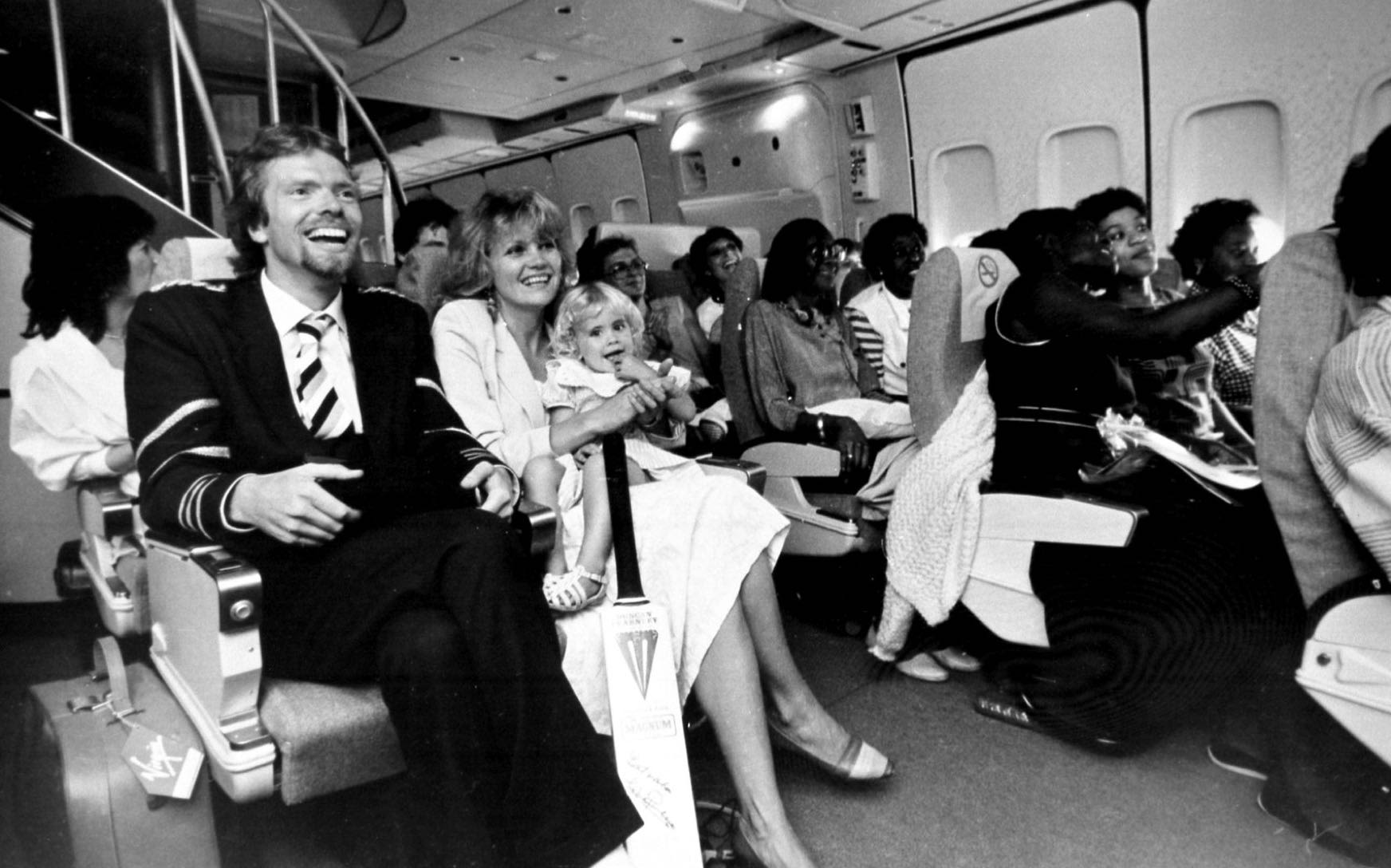 Richard and family sitting on their seats on Virgin Atlantic's inaugural flight