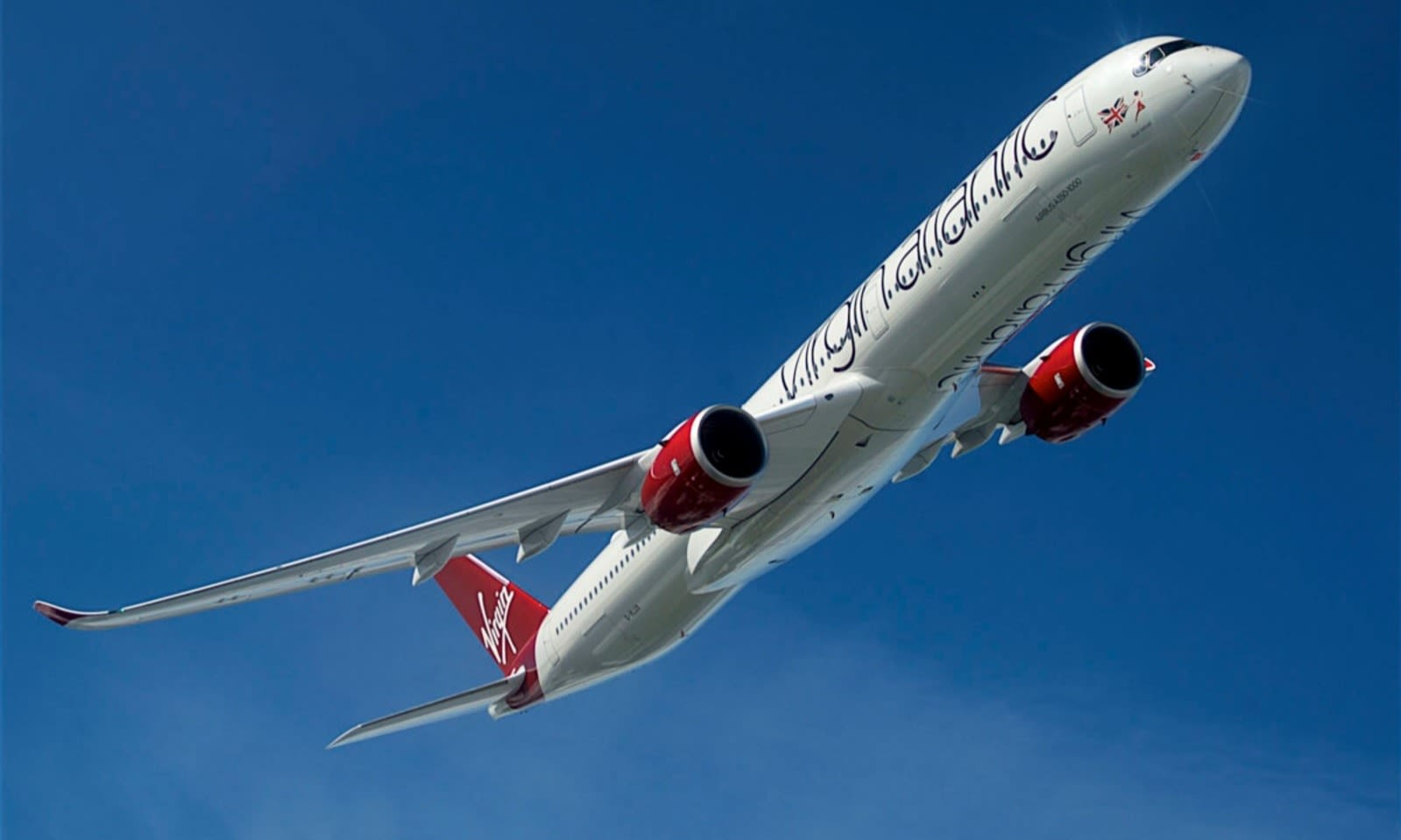 A Virgin Aircraft in flight through blue skies