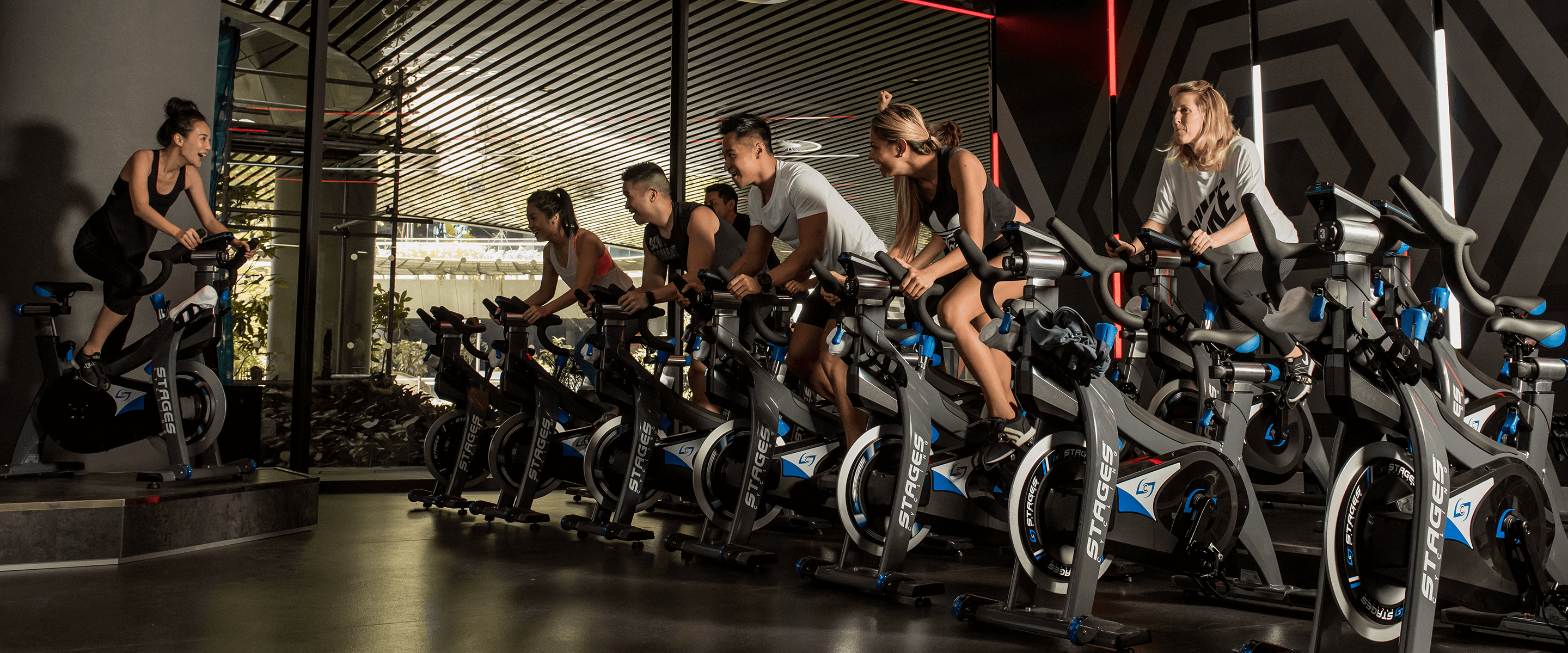 People take part in an indoor cycling class at Virgin Active South Africa