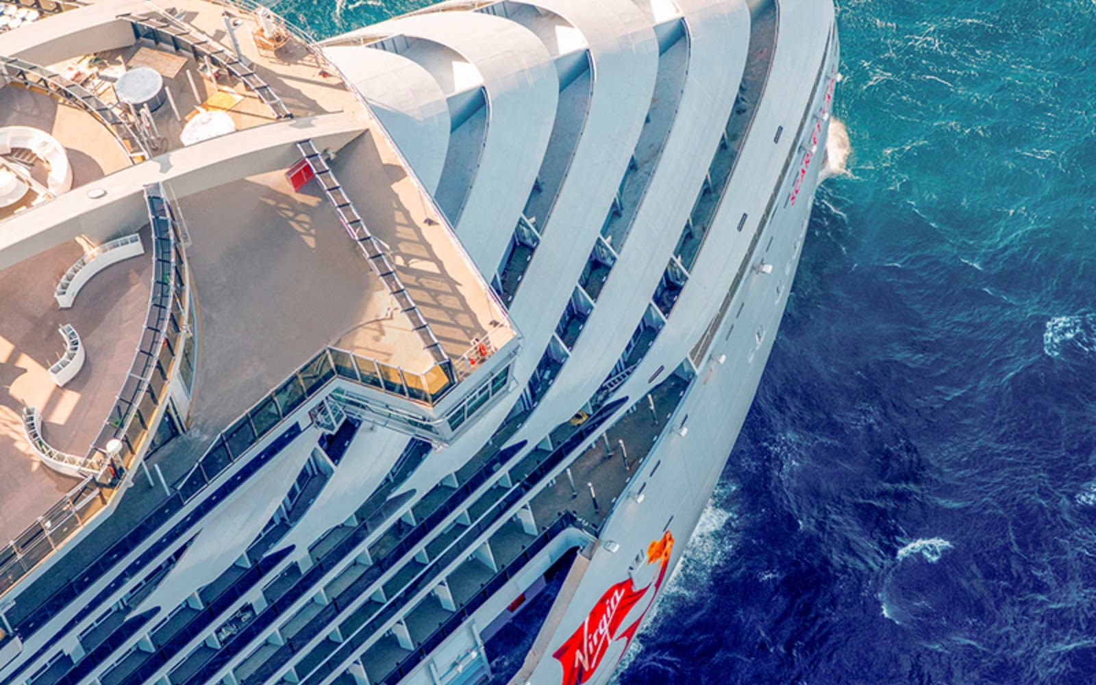 Picture looking down at the front of Virgin Voyages' ship Scarlet Lady