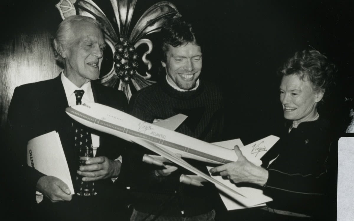 Richard Branson with his parents Ted and Eve holding a model Virgin Atlantic plane