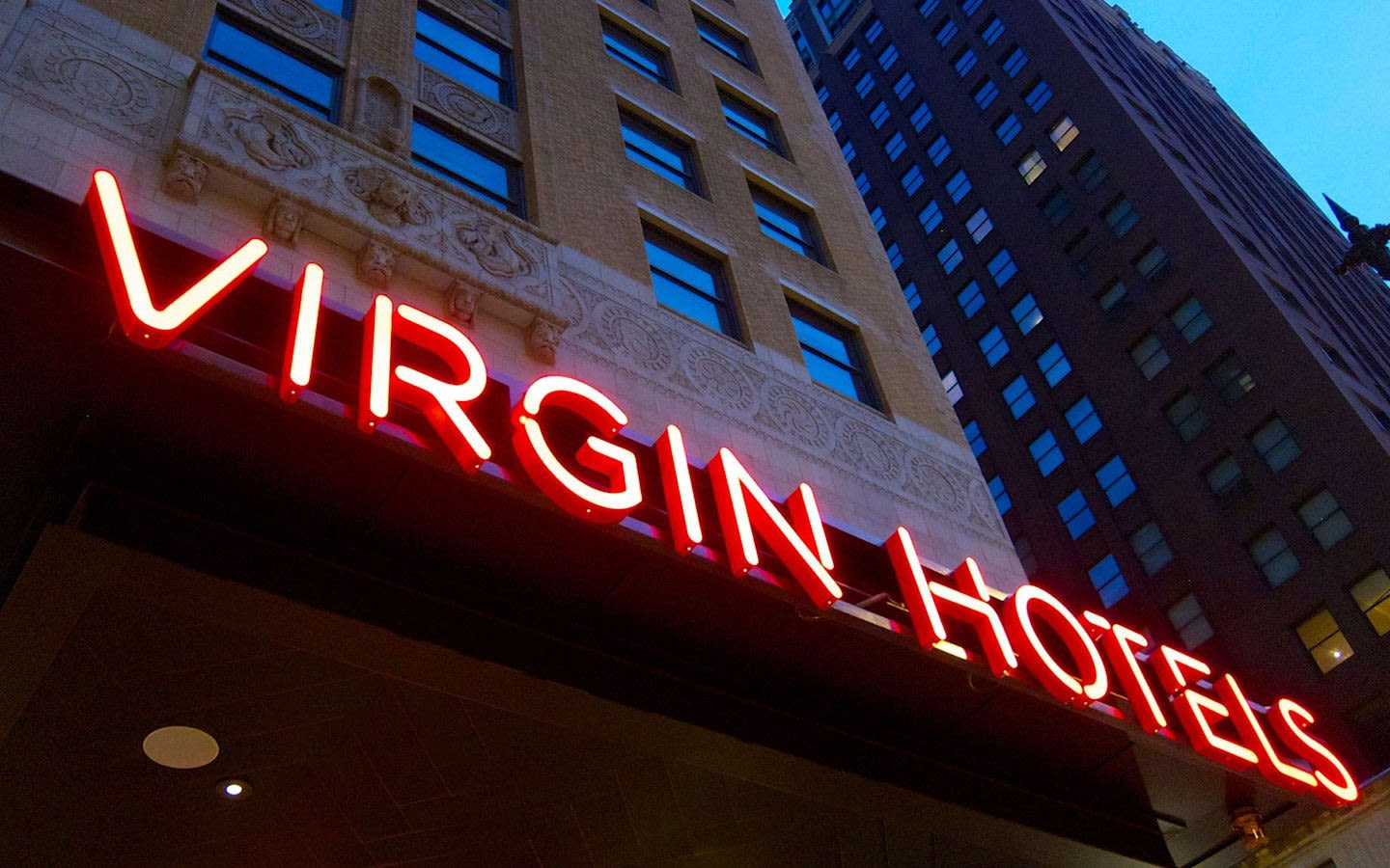 Picture from a view point of looking up to a Virgin Hotel Sign