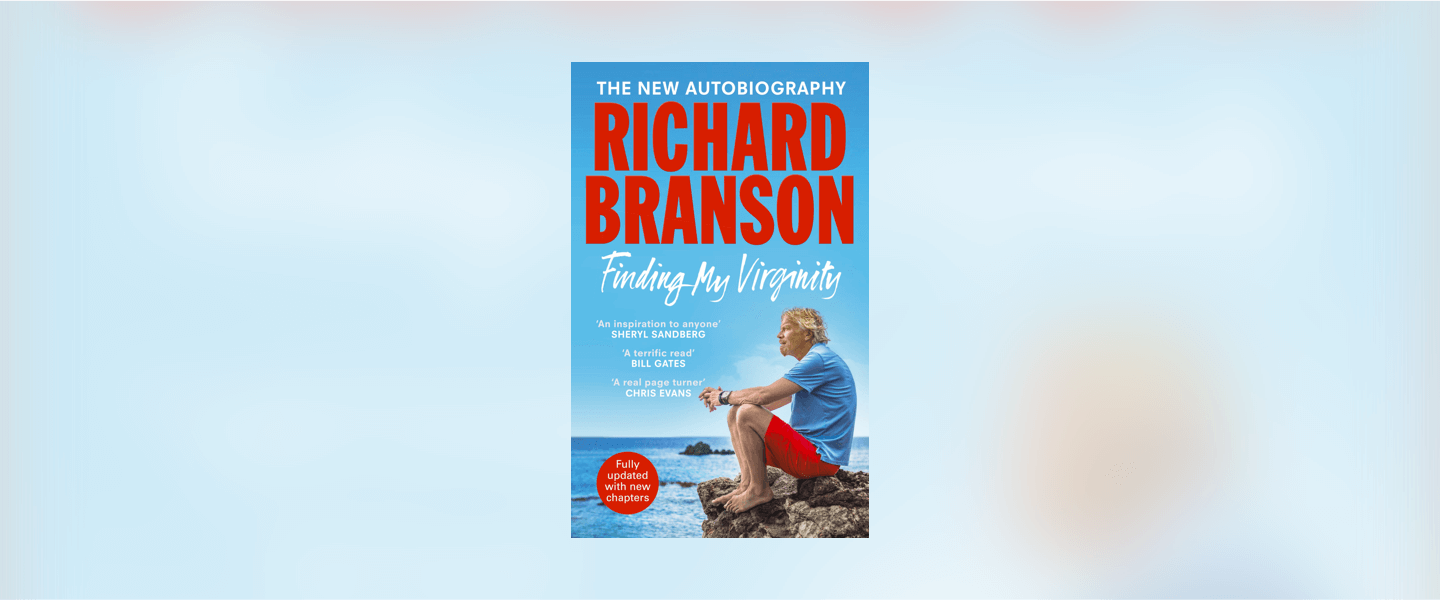 Richard Branson sat on a rock looking at the sea for his book cover