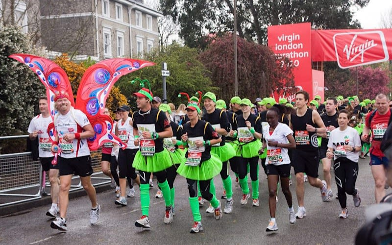 Richard Branson, Sam Branson and Holly Branson run the Virgin Money London Marathon with other members of the Big Change team dressed as a butterfly and caterpillar