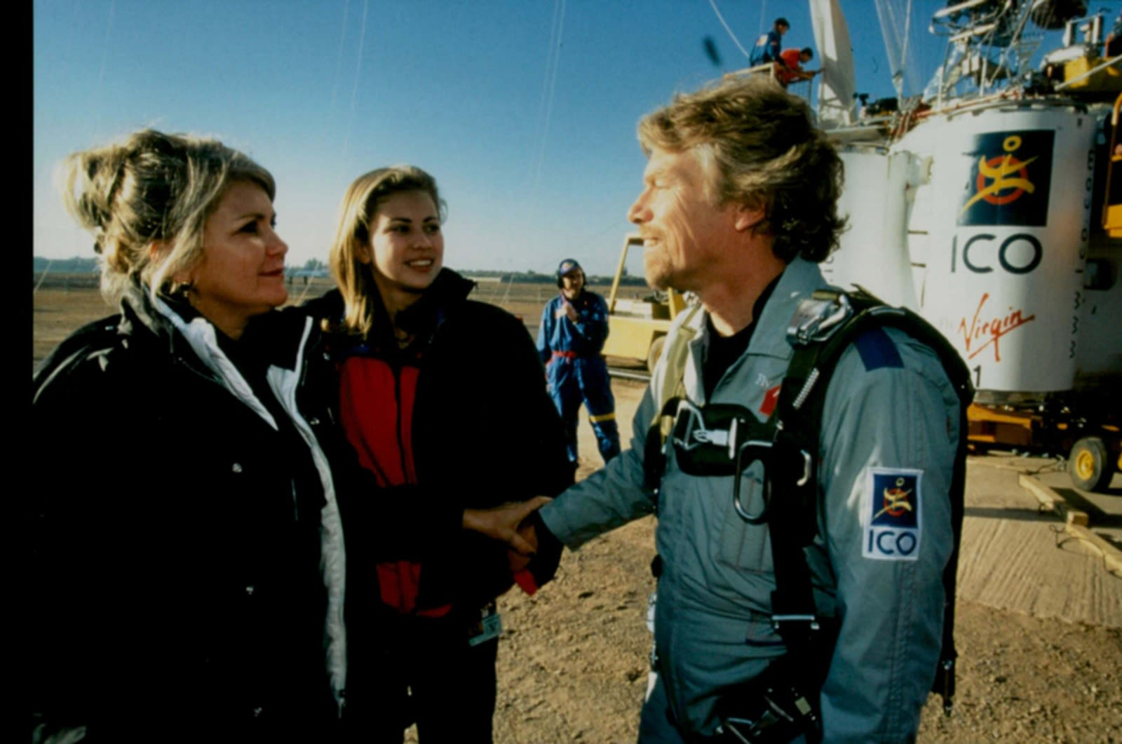 Joan Branson with Holly Branson and Richard Branson in front of a hot air balloon