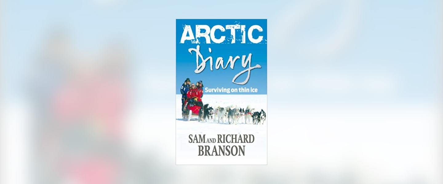 Front cover of the book Arctic Diary, with Sam and Richard Branson in the snow with a pack of husky dogs in front of them