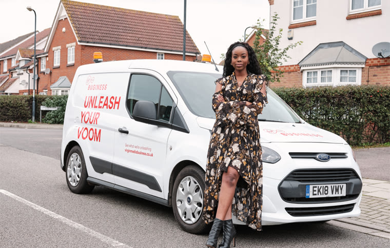 Epiphannie A founder Annie Amusu standing in front of a Virgin Media van