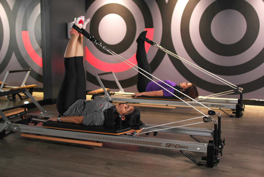 People practising reformer pilates at Virgin Active Thailand