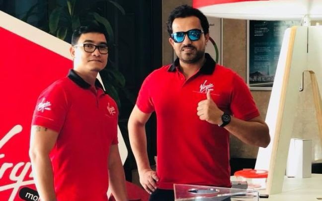 Habib Ghazi with a colleague at Virgin mobile UAE