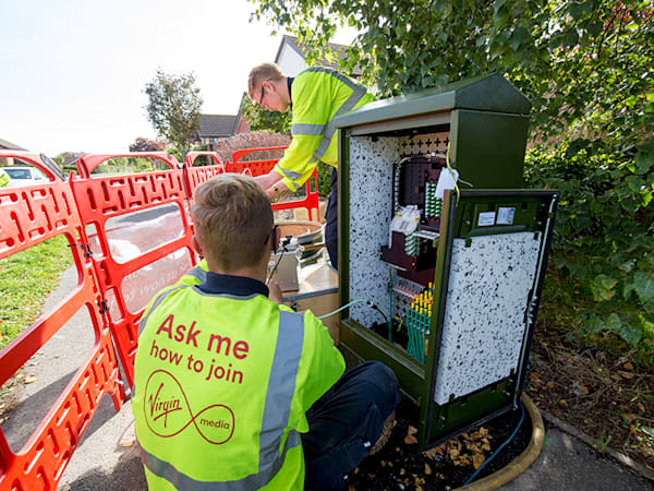 Virgin Media engineers work in the street