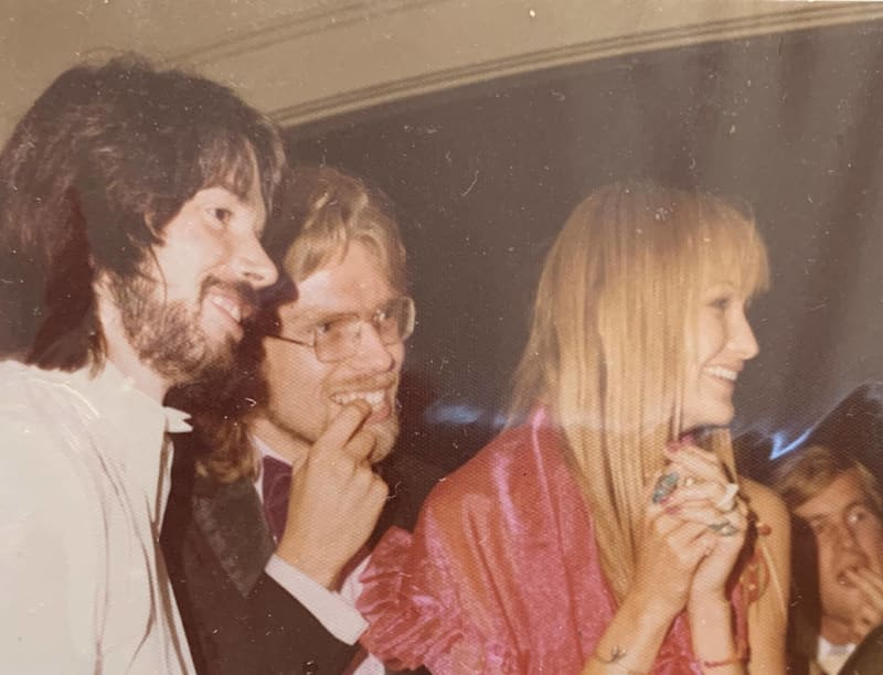 A young Richard Branson alongside Nik Powell and a woman with blonde hair