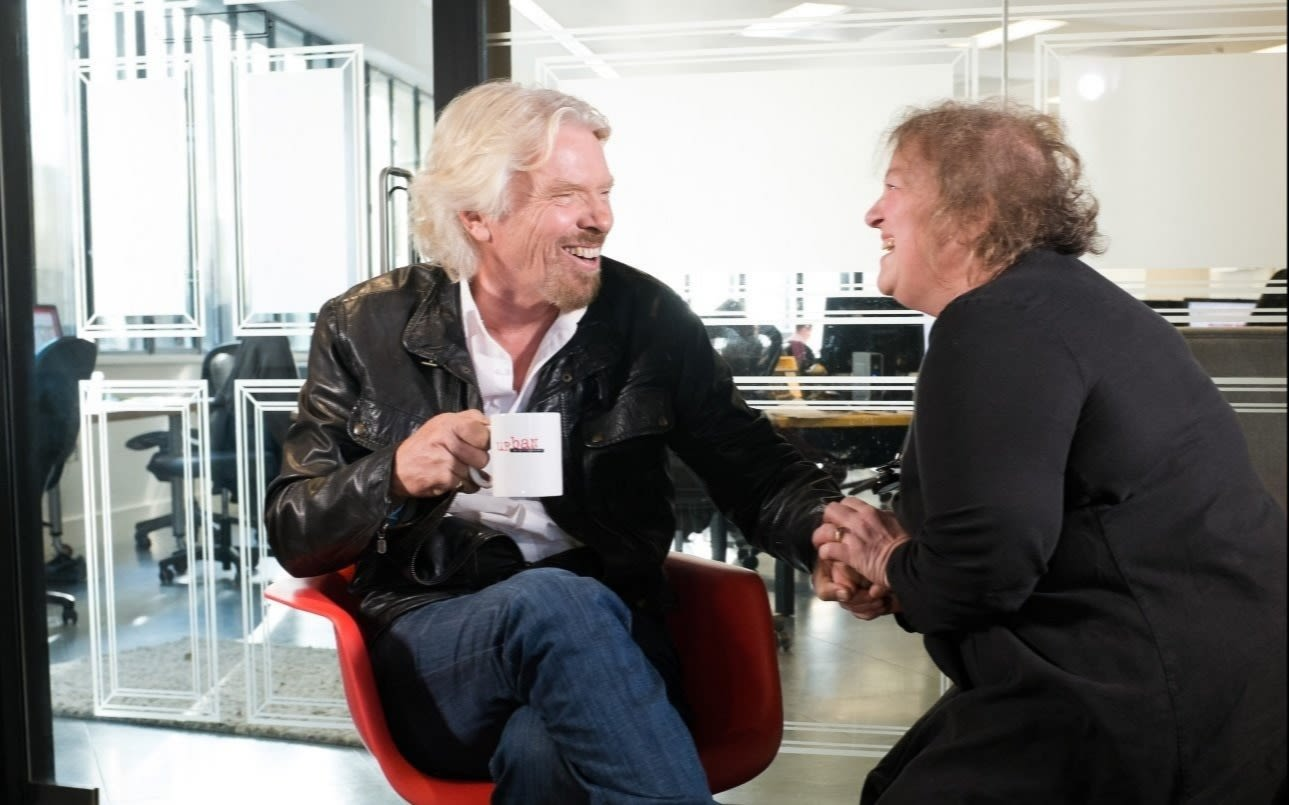 Richard Branson laughs with Christine Taylor, founder of Choccywoccydoodah