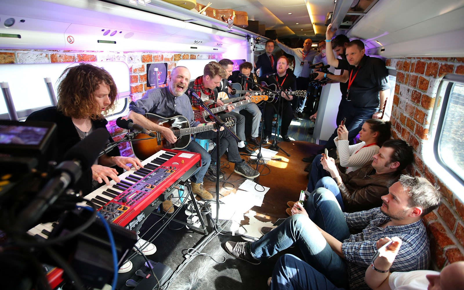 A band performs on a Virgin Train for the launch of Virgin Radio UK in 2016