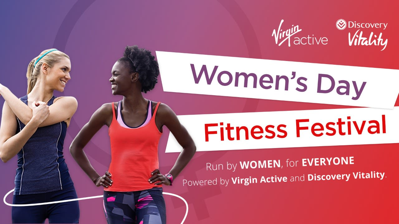 Virgin Active Women's Day Fitness Festival - two women smiling while exercising