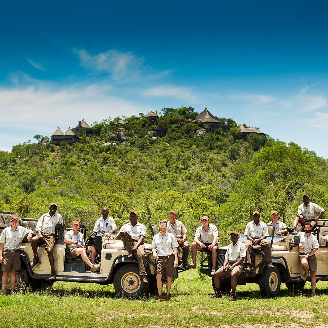 A group of rangers standing in front of Ulusaba Rock Lodge