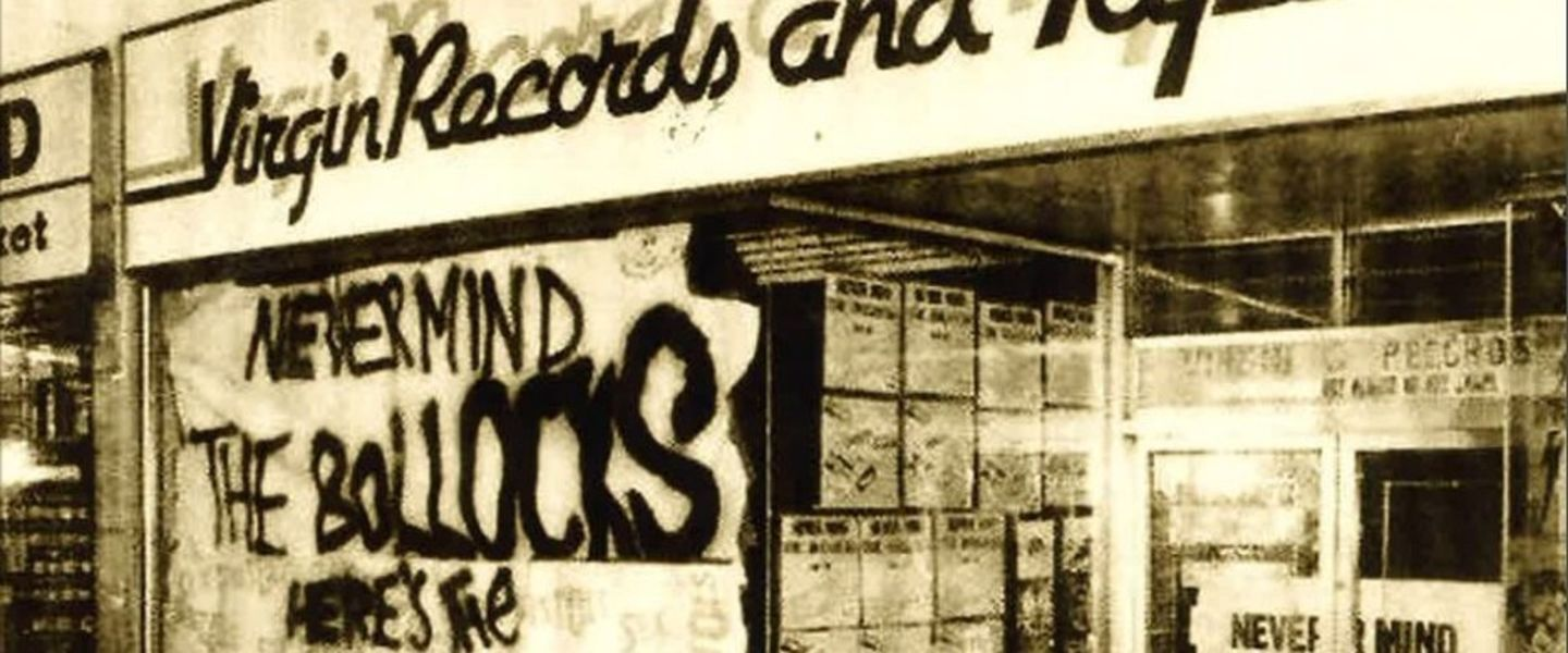 Black and white image of 'Never Mind The Bollocks' sign in-front of Virgin Records store