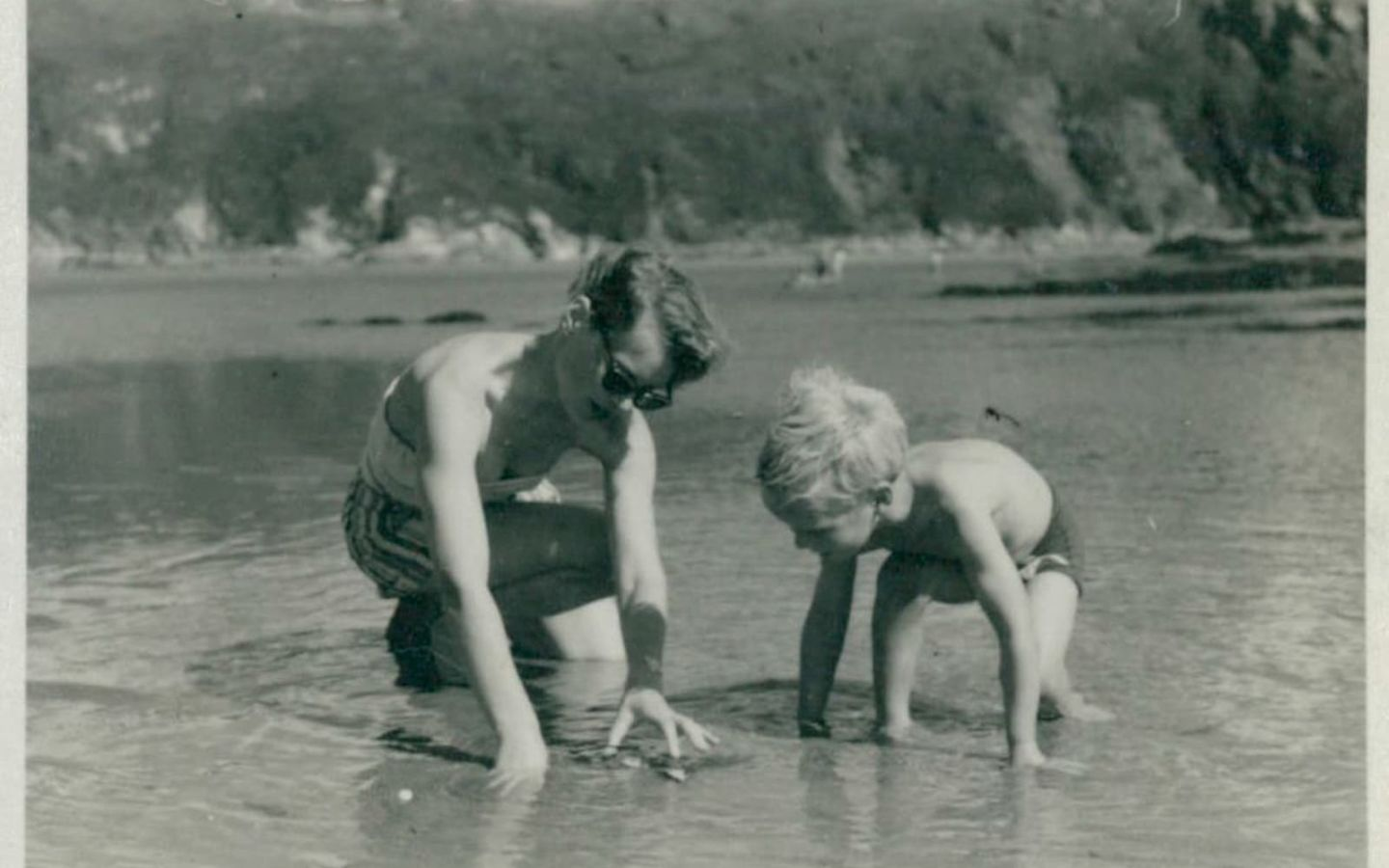 An old photo of Richard Branson playing in water with his mother Eve Branson