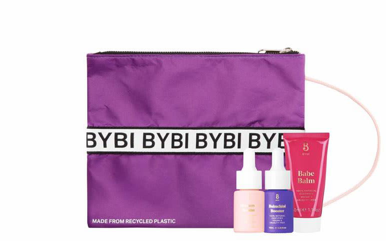 A BYBI toiletries bag with three BYBI products