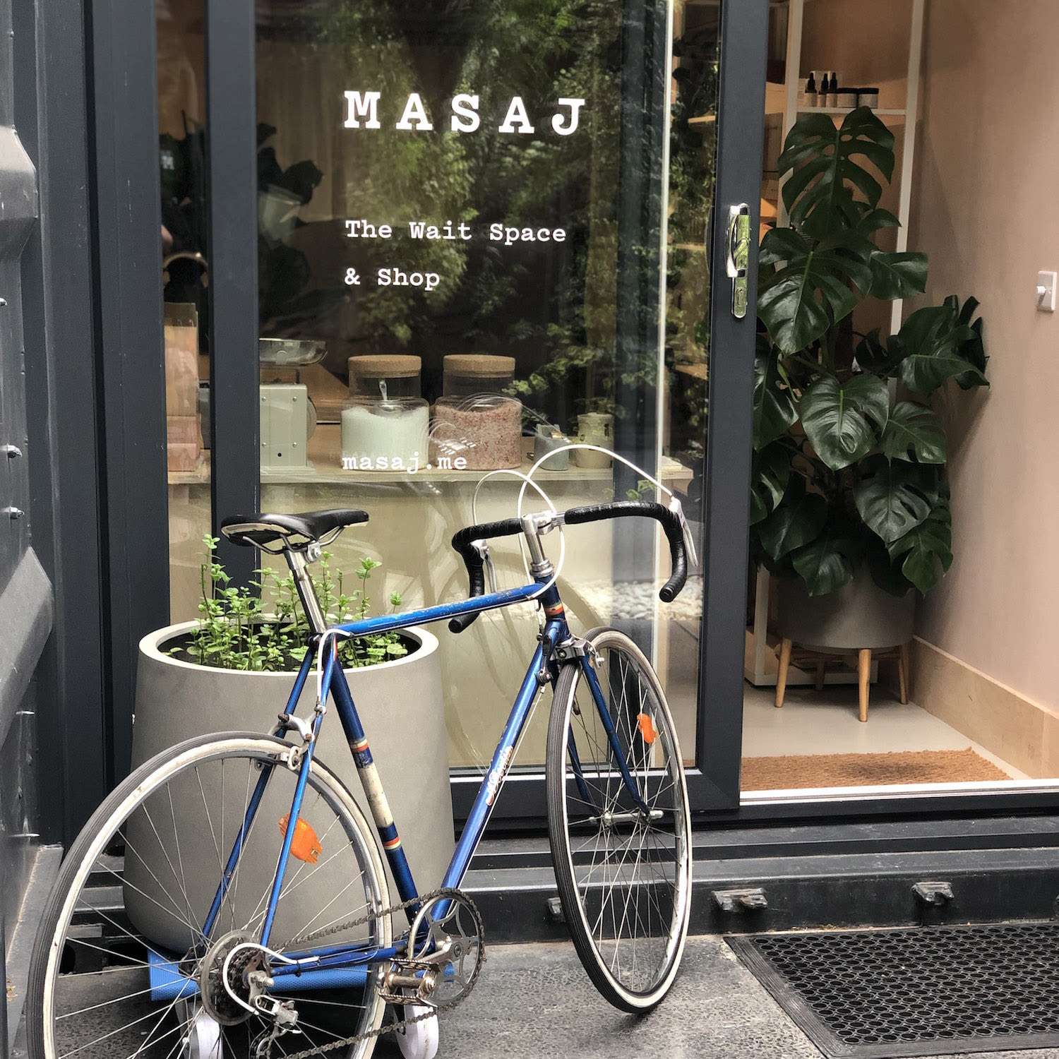 A bike outside the MASAJ studio