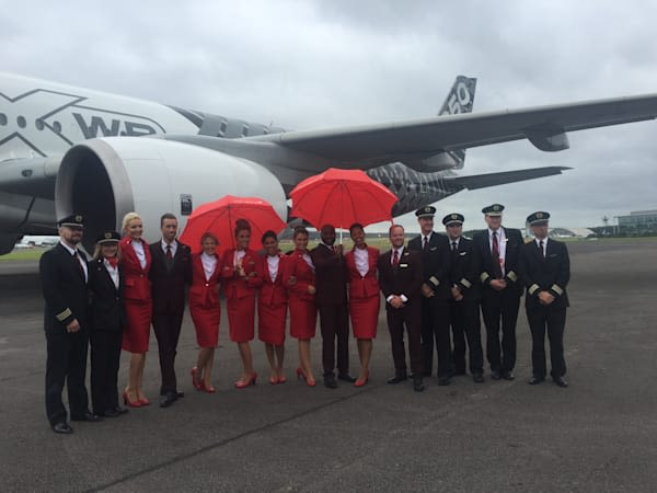 Virgin Atlantic crew stand in front of an Airbus A350 aircraft