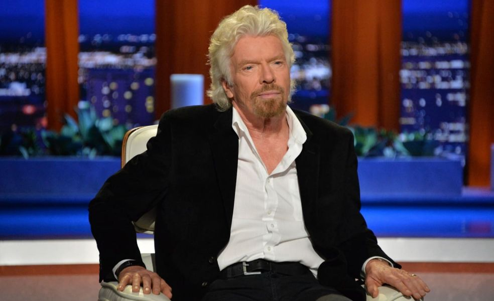 Richard Branson sitting down in armchair