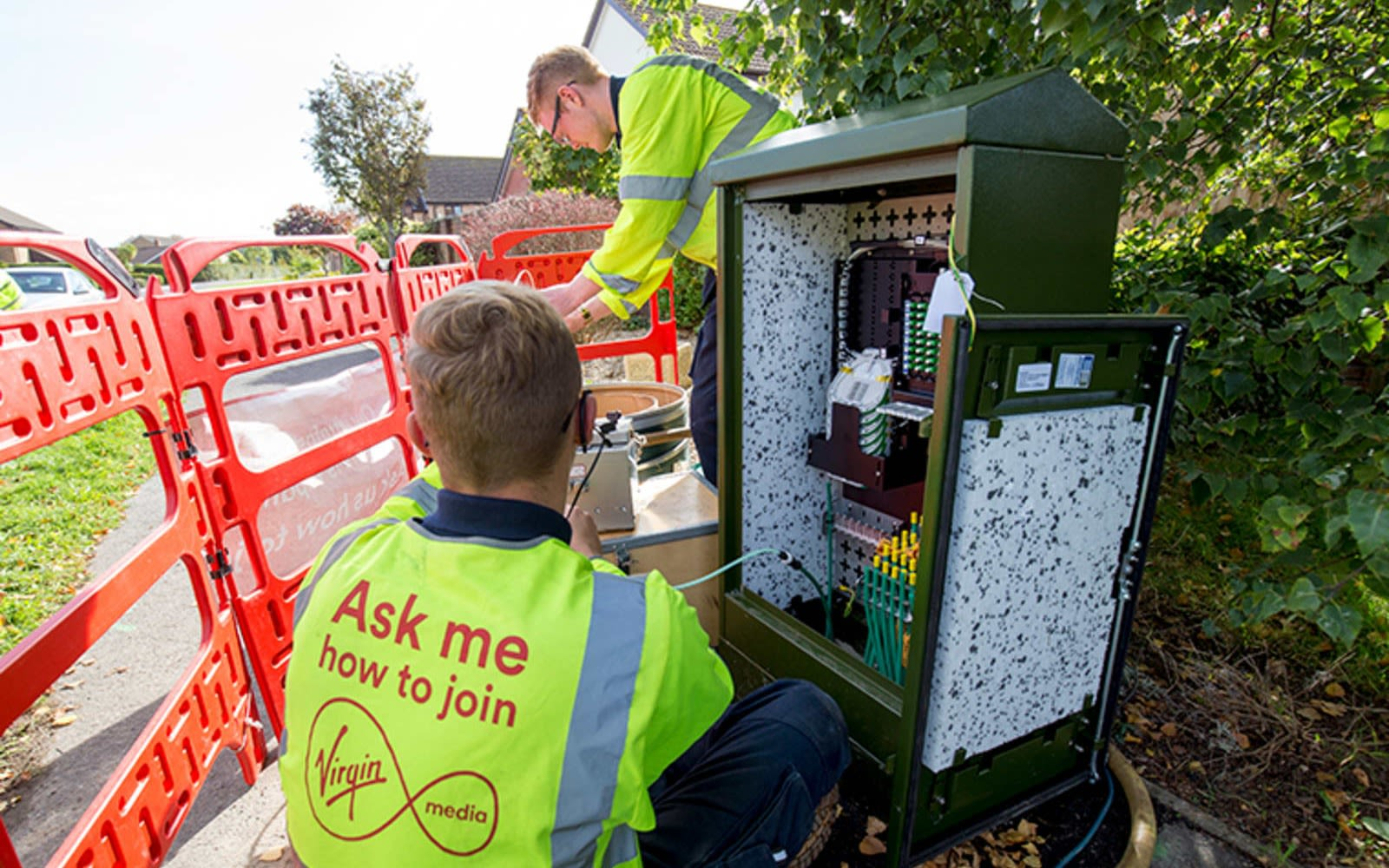 A Virgin Media engineer connects a broadband connection at an exchange point