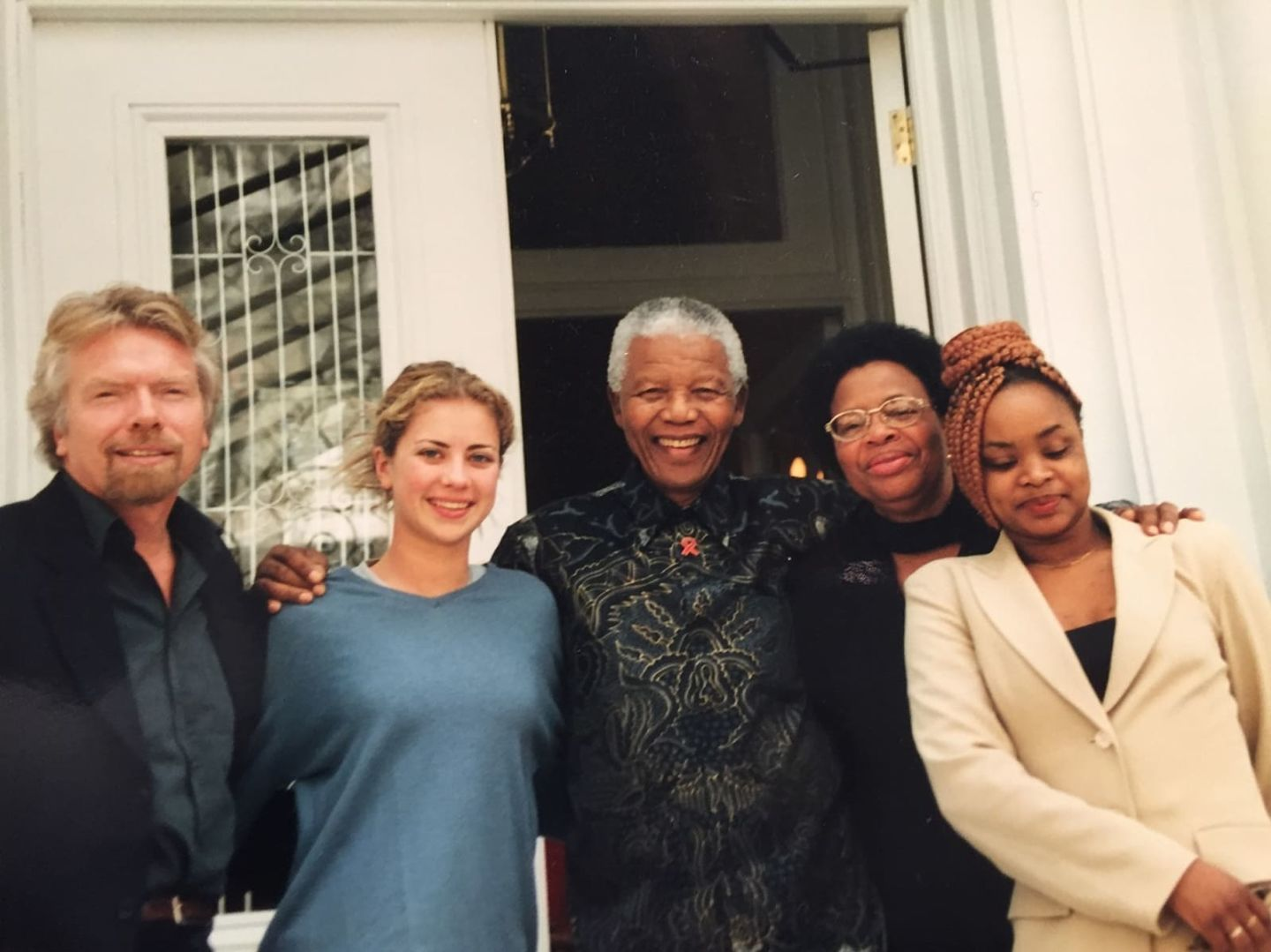 Richard, Holly and Nelson Mandela and family standing outside together