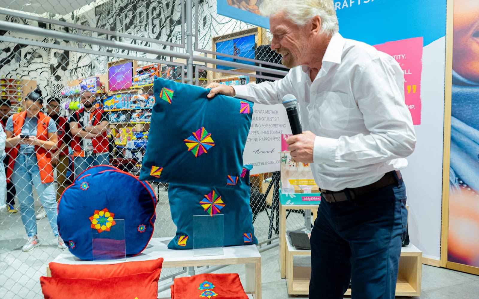 Richard Branson at Virgin Megastores holding a pillow from Made51